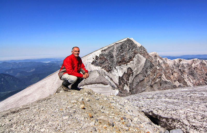 "It was an unusually cold spring in the Pacific Northwest and it was no surprise to encounter snow at 6,000 feet in mid-July. The 15 to 20 foot cornices around the rim made it difficult to see the lava dome from the 8,365 foot summit. I decided to climb the crater peak behind me with the intention of getting a better view. When I arrived at the top, I saw a wooden cross that had the words: ""In Memory of Joe"" written on it. The cross was for Joseph Bohlig, age 52, who was standing on the crater rim with his friend to pose for a picture. The cornice broke, and he fell 1,500 feet to his death on 2-15-10. It was his 68th time to the summit."