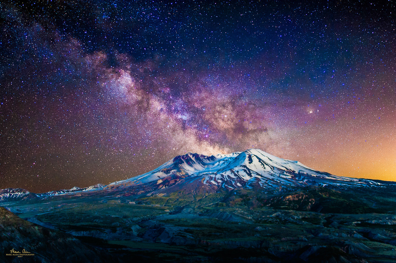 The Milky Way over Mt. St. Helens, as seen near the new moon on May 26, 2017.  I cheated a bit here: I mixed an image of the Milky Way from later in the evening with the mountain a short time after sunset (when the air was still glowing).  The orange glow to the right is light pollution from Portland, Oregon.