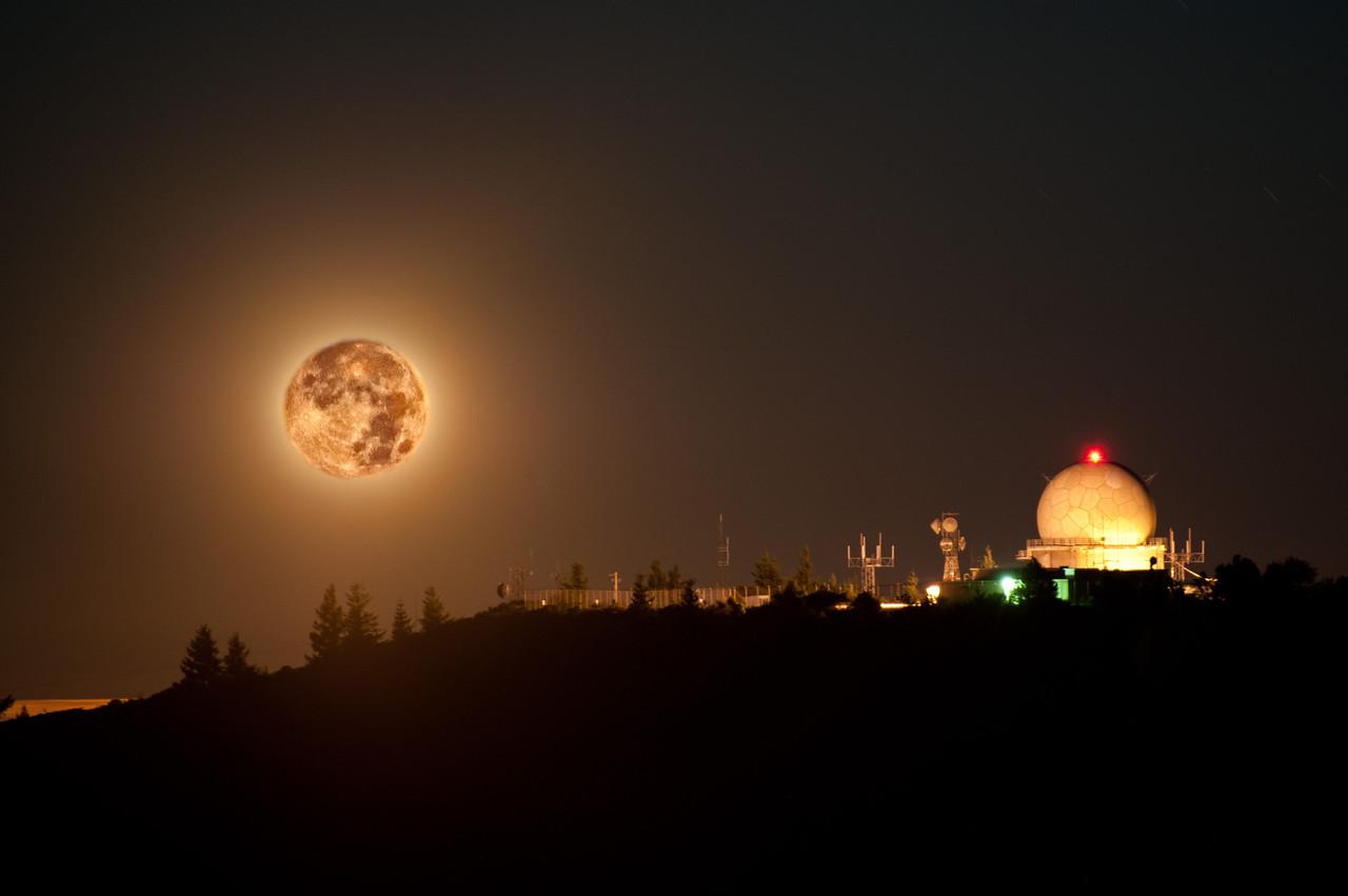 Full moon over the FAA radome on middle peak.