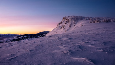 Cache and Harrison warm in the alpenglow.
