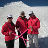 Nikki, Kristin, and Lynn - the 3 cancer survivors of the climb - modeling their 'survivor' jackets and breast cancer pink ice axes.<br /> photo by Lynn's camera