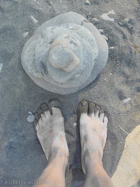 Michelle's sand covered toes and some rocks.