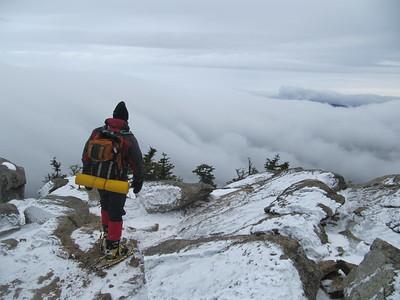 Mike looking towards Mt. Flume hidden in cloud cap