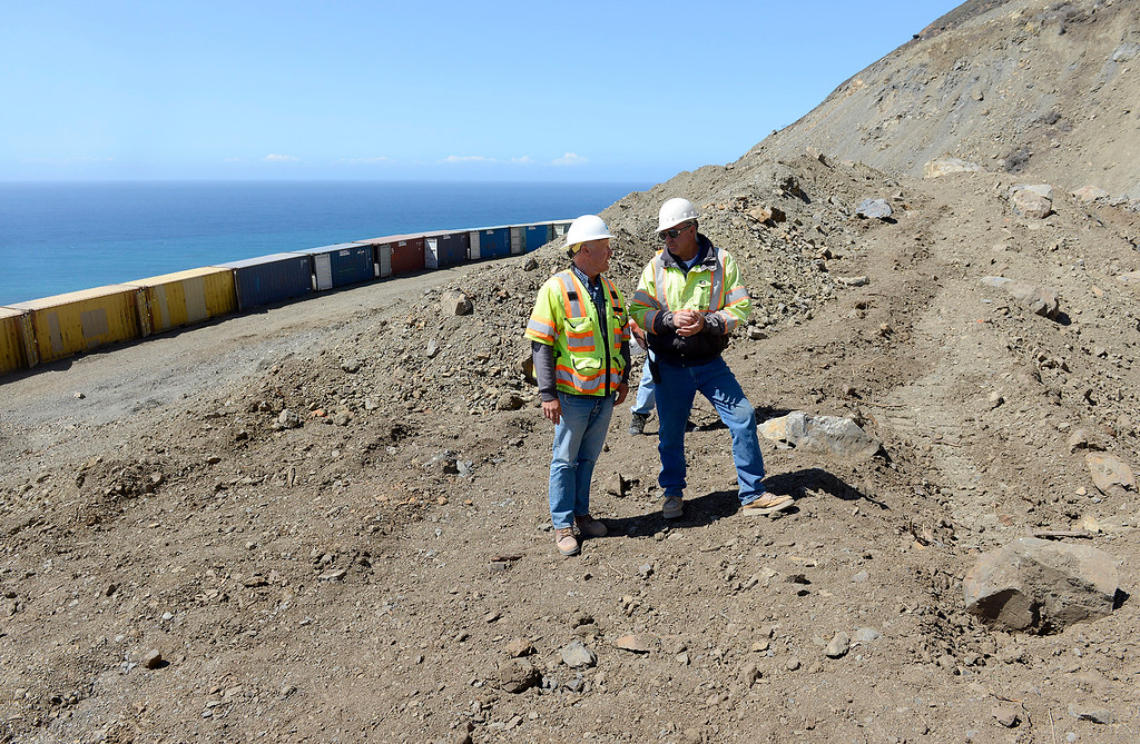 . Cal Trans engineer Wayne Walker and JMC contractor Augie Wilhite at the north end of the Mud Creek Slide in southern Monterey County on Highway One on Thursday, Sept. 21, 2017.   (Vern Fisher - Monterey Herald)