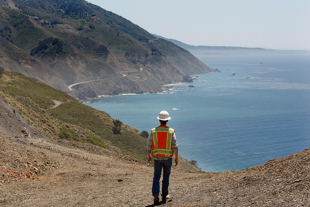 . Joe Erwin, Cal Trans project manager walks a section of the Mud Creek slide south of Big Sur on Highway One on Monday, May 7, 2018.  (Vern Fisher - Monterey Herald)