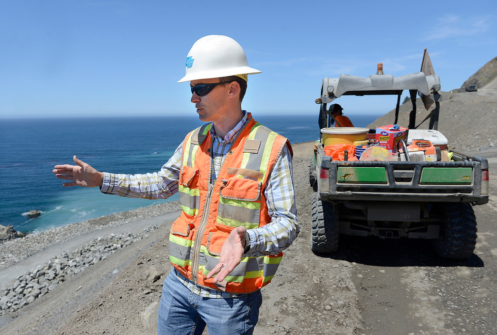 . Joe Erwin, Cal Trans project manager explains the purpose of the revetment wall at the Mud Creek slide south of Big Sur on Highway One on Monday, May 7, 2018.  (Vern Fisher - Monterey Herald)