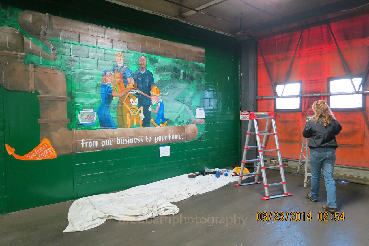Our artist took several weekend to complete  the mural  for the Wellness Center.