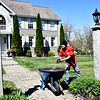 Nevin Beaudry of Tyngsboro and a worker for Muir Landscaping, working at a home in Pelham NH. SUN/ David H. Brow