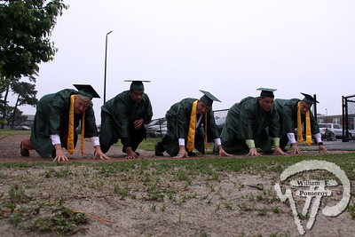 "The D-line takes one last stance with ""Staff"", ""Lo"", Kyle ""MIT"" Pina, ""Spike"" and ""Jay"", prior to their June 14 graduation from Dennis-Yarmouth Regional High School.  Pina later delivered the valedictory address."