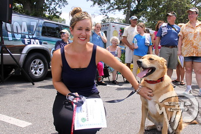 "Jasper with owner  Sophia Gianniotis of Harwich.   Agway of Cape Cod's  ""Top Dog"" Winner!   August 09, 2013  Jasper is, without a doubt, the complete ""Cape Cod dog"" package.   He lives on a cranberry bog which he frequents for muskrat  and frog hunting, and is happiest on the beach.  He isn't one of  those neurotic beach dogs that only want to dig or chase the ball  for hours.  Instead, he is a renaissance beach dog, swimming,  playing, running, digging, finding dead things, saying hi to other  people and dogs. On the porch in the evenings, he keeps watch over our 7 acre farm  in Harwich.  Jasper hasersonality in spades, from the way  he ""smiles"" when he greets someone he knows and loves, to his  ability to pick berries off the vine by himself. He is a steadfast  companion and absolutely our ""top dog"".   Congratulations Jasper & Sophia!  2013ADVERTISEMENT Agway of Cape Cod"