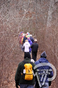 Descent  through the woods.  PHOTO GALLERY:  Walking Bells Neck , Harwich  With temperatures in the low 30s and not much sun, Pat Sarantis kept the chill at bay with  her brisk pace as she led a hike last week through the Harwich Conservation Trust's Bells Neck  Area. The one and a half hour walk provided plenty of variety. Pat took the group of 20 up and  down hills through woods, along marshes, next to the herring run, over a footbridge and around cranberry bogs. The paths varied from sandy soil to soft matted leaves and pine needles making  the walking quite comfortable. 4 / 7  WickedLocal.com/CapeCod January 23, 2012COMMUNITY NEWSPAPER COMPANY