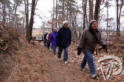 "Through the Harwich Conservation Trust,  ""More Walk, Less Talk"" took place this past Thursday.  PHOTO GALLERY:  Walking Bells Neck , Harwich  With temperatures in the low 30s and not much sun, Pat Sarantis kept the chill at bay with  her brisk pace as she led a hike last week through the Harwich Conservation Trust's Bells Neck  Area. The one and a half hour walk provided plenty of variety. Pat took the group of 20 up and  down hills through woods, along marshes, next to the herring run, over a footbridge and around cranberry bogs. The paths varied from sandy soil to soft matted leaves and pine needles making  the walking quite comfortable. 3 / 7  WickedLocal.com/CapeCod January 23, 2012COMMUNITY NEWSPAPER COMPANY"