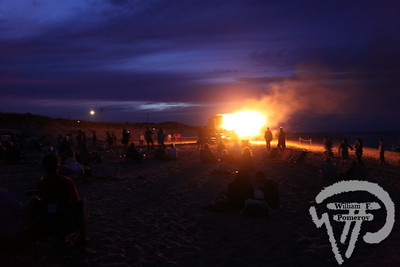 A crowd gathers  to watch the bonfire at Nauset Beach.  PHOTO GALLERY:  Celebrate Our Waters  Celebrate Our Waters took place at various Orleans venues Saturday and Sunday.  Talks, walks and boating programs focusing on the town's waters and heritage  were held throughout the weekend.. 13 / 19  WickedLocal.com/CapeCod September 26, 2011COMMUNITY NEWSPAPER COMPANY