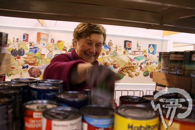 A HELPING HAND Jan Concannon from Harwich Port doesn't have to reach far to find her smile  when assisting those in need at The Family Pantry.  Harwich Oracle January 23, 2013 front page
