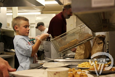 A HELPING HAND . . . Charlie Baroni, 9, lends a helping hand at the Harwich-Dennis  Rotary Club's Annual Scallop and Chowder Fesitval, held last Saturday  at the Weatherdeck Restaurant.  Harwich Oracle October 17, 2012 front page