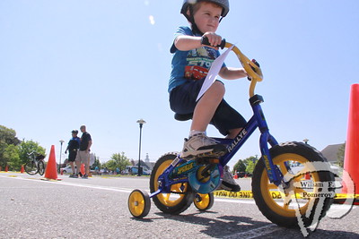 BEGINNING BIKER Owen Cloney, 4, from Harwich keeps his balance  while completing a Turtle Race at the Bicycle Rodeo  outside the Harwich Community Center Saturday.  Harwich Oracle June 5, 2013 front page
