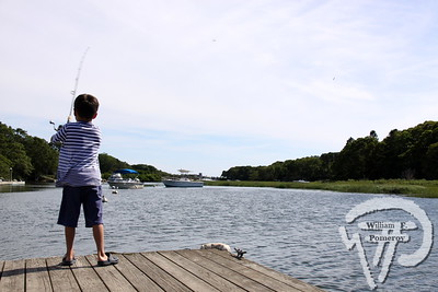 A RIVER RUNS THROUGH IT Leo Castagna, 5, of Newtown, Conn.  casts into the Herring River.  Harwich Oracle July 25, 2012 front page