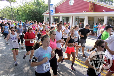 ROAD WARRIORS Under a hot sun Saturday morning, more than 700 runners competed in  the fourth annual Harwich 5K Road Race, which began on Main Street  in Harwich Port. More photos online. Harwich Oracle  JUNE 26, 2013 front page