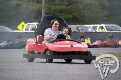 FAST AND FUN! Rose Oleksak from Westfield joins 7-year-old Chris O'Connor of Chicopee  for a spin around the track this past week at Bud's Go-Karts  in Harwich Port.  Harwich Oracle July 10, 2013 front page