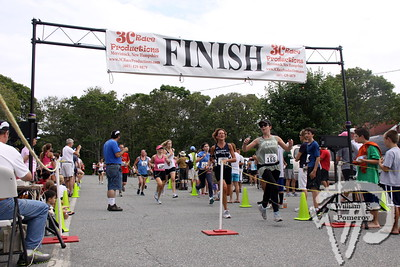 Runners finish the Harwich 5K race Saturday morning.  The event raised money  for youth fitness programs in town.  Top finishers included Edward Harvey,  from Needham (17:04); and Dawn Varnum, of Orleans (19:55).