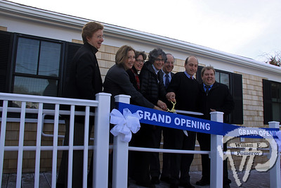 Cold weather last Friday did not prevent WE CAN's ribbon cutting ceremony  to their new offices at 783 Route 28 Harwich Port.  Left to right: Dottie Smith, chief of staff for Rep. Sarah Peake;  Dorothy Savarese, president and CEO, Cape Cod 5;  Pam Marsh, chairman of WE CAN's board of directors;  Andi Genser, WE CAN executive director;  State Rep. Cleon Turner;  State Sen. Dan Wolf;   Jeremy Gingras, executive director, Harwich Chamber of Commerce.
