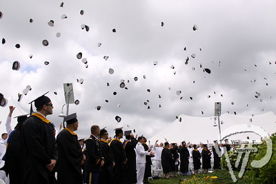 The weather held up, but the members of the Massachusetts Maritime Academy  Class of 2012 littered the sky with their caps Saturday, June 16 as commencement  exercises came to an end.
