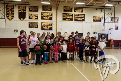 HAVING A BALL Santa joins children from Grades 1 through 6 and Cape Cod Regional  Technical High School basketball players at their annual winter basketball  clinic on Saturday.  Harwich Oracle  DECEMBER 19, 2012 front cover