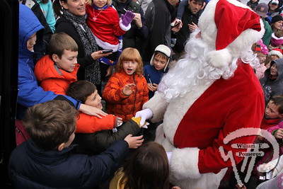 GREETINGS! Families mob Santa Claus at Orleans Yacht Club  after his arrival last Saturday. The Cape Codder NOVEMBER 30, 2012front cover