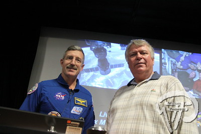Astronauts, Capt. Dan Burbank, left, and Dr. Byron Lichtenberg, shared stories from their time in space.