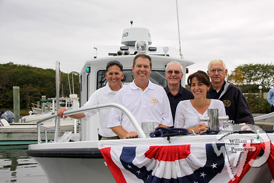 ALL ABOARD! The Harwich Harbormaster's new patrol boat, Marine 77, was officially christened Friday  at Saquatucket Harbor.  Pictured on the new boat are John Rendon, harbormaster;  Heinz Proft, natural resources director;Jim Coyle, assistant harbormaster,  Michelle Morris, executive assistant in the harbormaster department and Frank Kunz,  assistant harbormaster.  Deacon John Foley from Holy Trinity Catholic Church  blessed the vessel before a crowd of well-wishers.  Harwich Oracle October 9, 2013 front page