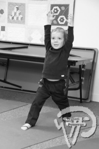"Five-year-old Julien Lajoie of Eastham  strikes his ""Buzz Lightyear"" pose  during Yoga Kids. The Cape Codder MARCH 11, 2011page 13"