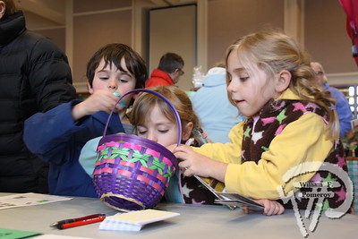 Home grownDominic Cappuccino, 6, of East Falmouth, Jessie, 4,  and Lucy Swain, 6, of Harwich raid a basket of sweets  provided by Brewster based Eldredge Farm. Harwich Oracle MARCH 16, 2011page 7