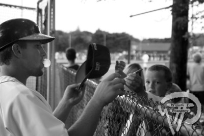 Mark Fleury blows a bubble during the pregame autograph sessionon Saturday.  Fleury came through with a two-run home runto give the East squad an 8-6 win over the West. The Cape Codder AUGUST 1, 2008page 35