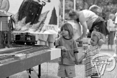 Watch it goA model train captures the attention of siblingsGabriel and Sage Cundari of Vermontat the Eastham Hands on the Arts Festivallast weekend. The Cape Codder JUNE 26, 2009page 22