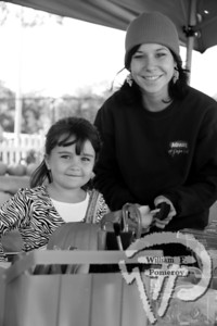 Siena Healy, a four-year-old from South Yarmouth,poses under the pagoda with Amanda Pimentalduring a recent Pumpkin Patch Party at Agway of Cape Cod. The Cape Cod Chronicle OCTOBER 28, 2010page 45