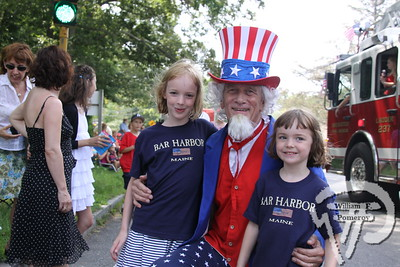 Lowrie, 8, and Sara Woodside, 5, from Pittsburgh, Pa., celebrate with Uncle Sam. The Cape Codder JULY 8, 2011page 18