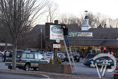 Craig Randall, of Friends' Marketplace,hangs holiday lights. The Cape Codder DECEMBER 3, 2010page 19
