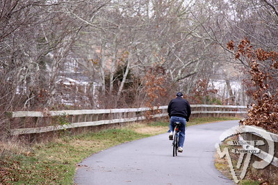 ROLLING ALONG A rider  enjoys the Cape Cod Rail Trail. Harwich Oracle JANUARY 23, 2012page 4
