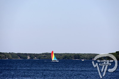 A Hobie Cat hauls on a starboard tack  across Long Pond.  Harwich Oracle  JULY 11, 2012 page 4