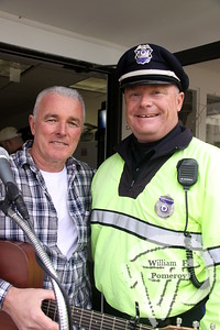 Singer/guitarist Dave Hickey  accompanies Chatham policeman John Whittle.