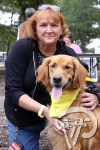 """Tucker, golden retriever,  plus Deb Heemsoth.  SEEN ON SCENE:  DogFest in Dennis  Canine Companions for Independence inaugural DogFest attracted paws full of four-legged friends  and their masters to Johnny Kelley Park in South Dennis this past Saturday afternoon. To learn more about  the organization """"capable of transforming the lives of people with disabilities"""", please visit them on-line  at cci.org   2 of 18   WickedLocal.com/CapeCod October 7, 2013 COMMUNITY NEWSPAPER COMPANY"""