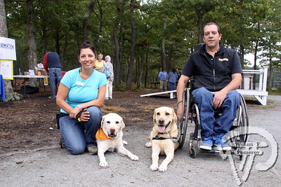 """Micah and Fiore, lab-retrievers,  beside their companions.  SEEN ON SCENE:  DogFest in Dennis  Canine Companions for Independence inaugural DogFest attracted paws full of four-legged friends  and their masters to Johnny Kelley Park in South Dennis this past Saturday afternoon. To learn more about  the organization """"capable of transforming the lives of people with disabilities"""", please visit them on-line  at cci.org   14 of 18   WickedLocal.com/CapeCod October 7, 2013 COMMUNITY NEWSPAPER COMPANY"""