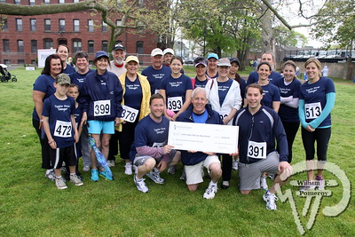 Rogers & Gray Insurance company provide general support  to Cape Abilities president Larry Thayer. SEEN ON SCENE:  Cape Abilities 5K  Despite an early slight rain, more than 500 runners and walkers  came out Saturday morning to take part in a 5K Walk/Run in downtown  Hyannis. Exceeding their goal in raising over $50,000 for Cape Abilities,  a program which has been supporting people with disabilities across  Cape Cod for over the past 40 years.  7 / 17   WickedLocal.com/CapeCod May 13, 2013 COMMUNITY NEWSPAPER COMPANY