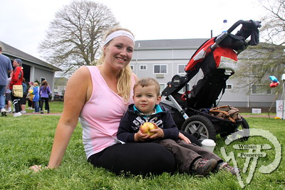 Katey Shanahan from Centerville  accompanies her nephew Colton Baisley. SEEN ON SCENE:  Cape Abilities 5K  Despite an early slight rain, more than 500 runners and walkers  came out Saturday morning to take part in a 5K Walk/Run in downtown  Hyannis. Exceeding their goal in raising over $50,000 for Cape Abilities,  a program which has been supporting people with disabilities across  Cape Cod for over the past 40 years.  3 / 17   WickedLocal.com/CapeCod May 13, 2013 COMMUNITY NEWSPAPER COMPANY