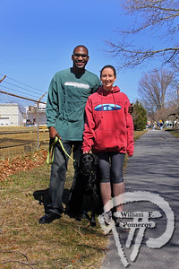 Three year-old black lab Olive joins Jeffrey Berleus and Alexandra Wallace  of Wellfleet. SEEN ON SCENE:  Along the  Cape Cod Rail Trail Along the Cape Cod Rail Trail mixed with warmer weather  this past Saturday heightened curiosity for some to explore  from Brewster to Wellfleet's town line.   8 — 12  WickedLocal.com/CapeCod April 1, 2013 COMMUNITY NEWSPAPER COMPANY