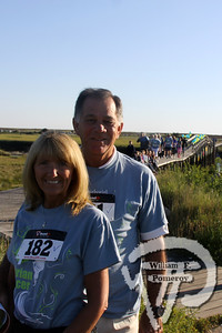 Diane  and Rev. Jim Scovil.  SEEN ON SCENE:  girlygirl P.A.R.T.S. fourth annual 5K Run/Walk for Ovarian Cancer girlygirl P.A.R.T.S. fourth annual 5K Run/Walk for Ovarian Cancer attracted over 900 participants to the Sandwich Boardwalk at Town Neck Beach this past Saturday. To learn more and/or donate to this cause, please visit them on-line at girlygirlParts.net Pre-screening Awareness Required To Silence... Ovarian Cancer brought together love, hugs and exercise!   20 of 25   WickedLocal.com/CapeCod September 9, 2013 COMMUNITY NEWSPAPER COMPANY