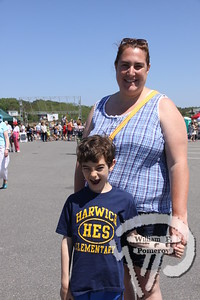 Maxwell and Jill McGrady  of Harwich. SEEN ON SCENE:  Wellfleet  HarborFest  Wellfleet HarborFest and Nautical Flea Market kicked-off  another summer season upon the Eastern end to the town pier  on Saturday. Along with multiple live entertainers, vendors,  local foods, auctions and items frequently raffled, the third  annual festival showcased a waterfront community under  the ever shining sun.  8 / 20   WickedLocal.com/CapeCod June 3, 2013 COMMUNITY NEWSPAPER COMPANY