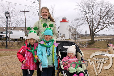 Cassidy Clifford of Dennis stands behind  Addison Violet, Loghan Clifford and Chloe Violet from Yarmouthport. SEEN ON SCENE:  Cape Cod St. Patrick's Day Parade  Large crowds were drawn along both sides of Route 28 this past Saturday  in West Dennis spilling into South Yarmouth, all to help celebrate  the 8th annual Cape Cod St. Patrick's Day Parade.   15 of 21  WickedLocal.com/CapeCod March 11, 2013 COMMUNITY NEWSPAPER COMPANY