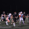 Sophomore Mason Bolivar scrambles away from the pack for a big running gain to the goal line.