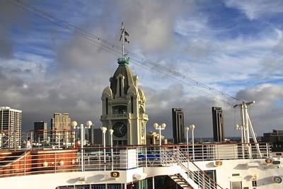 "Aloha Clock ""Piercing"" the ship's deck. Ship's clock has same time as Aloha Clock."
